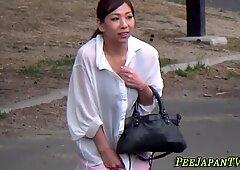 Oriental whore in high heels urinating