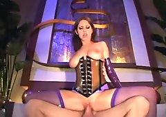 Brunette fucks in shiny latex corset and fishnets