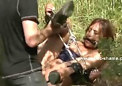 Bitch tied in cuffs in outdoor kinky sex