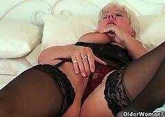 Chubby grandma in stockings rubs her pierced clit