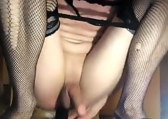 TS selffucked by huge dildo and gag on it